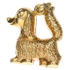 14 kt yellow gold pendant in the shape of a dog– Length: 11 mm.