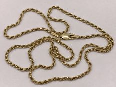 Handmade gold cord necklace.