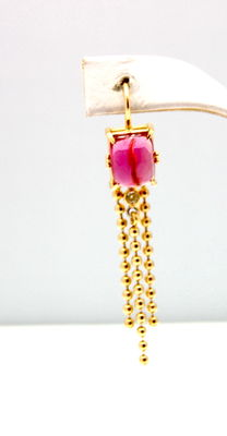 A pair of gold Diamond and Rubellite Tourmaline earrings.