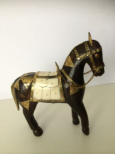 Handmade wooden horse with copper decorations