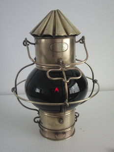 Brass ship's lamp with red glass