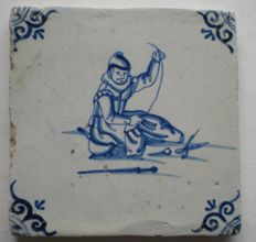 Antique tile with tailor (rare)