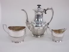 Antique jug with handle and smooth creamer and sugar bowl set with vertical patterns, ca. 1940