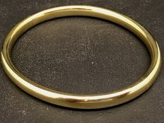 Wide bangle, 14 kt yellow gold