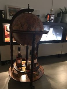 Large bar globe with coloured map with images from the 16th century