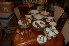 Porcelain dinner-service with matching cutlery