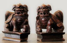 Pair of Fo dogs in carved wood - China - 19th century