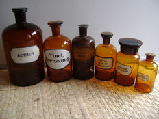 Set of brown glass pharmacists bottles with inscription