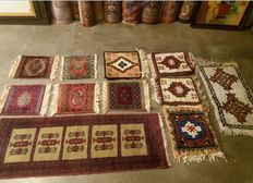 Lot of 11, oriental, hand-knotted, woollen rugs, 20 century.