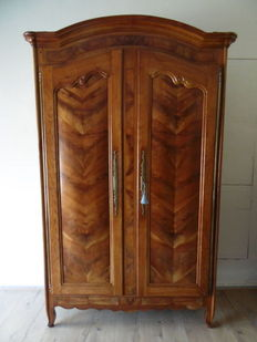 An attractive Louis XV style cherrywood armoire - probably Lyon - France - early 19th century
