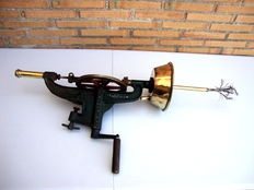 Antique machine for bottle cleaning.