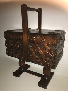 Wooden carved fold-out trapeze model sewing chest, ca. 1920