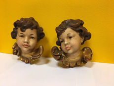 Two polychrome putti
