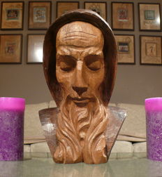 Statue of a monk, carved from wood.