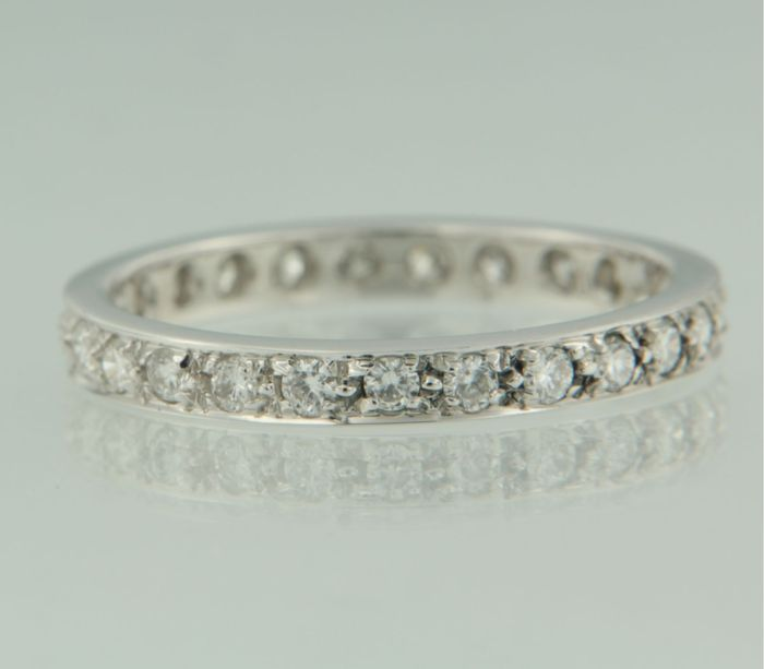 White gold 14 kt, full eternity ring,  set with 25 brilliant cut diamonds, ring size 17.25 (54)