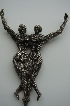 Silver pendant of woman and man.