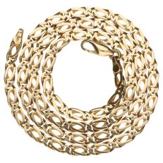 Yellow gold fantasy curb link necklace.