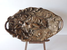Oval bowl in bronze - naked lying woman - decor of flowers