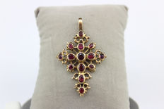 Gold cross pendant with garnets