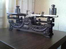 Beautiful heavy cast iron scales, with eight weights.