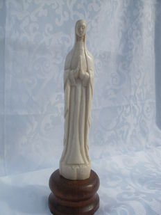 Large ivory madonna statue on wooden foot - Africa - 1920