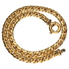 Yellow gold curb link necklace, clasp is set with a spinel