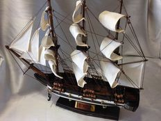 Vintage model of the USS Constitution, all artisan, wood and fabric and guns in bronze