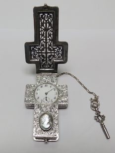 Handmade watch pendant in the shape of a cross, in sterling silver. Circa 1880.