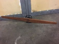 Wooden propeller on cast iron stand