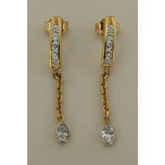 18 kt bi-colour gold dangle earrings with oval and lion cut diamond, approx. 0.80 ct in total, Wesselton VS-SI ****No reserve price****