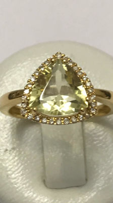 Gold ring set with a peridot and diamonds    without reserve price