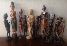 Collection of 11 wooden statues