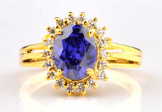 18 Kt Yellow Gold Ring with 2.0 Carat Natural Blue Tanzanite and 18 Natural brilliant diamonds 0f 0.35 carats