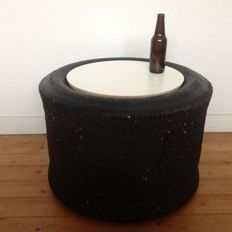 Side table of an old racing tyre
