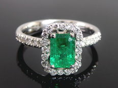 """Diamond ring with   """" natural  intense green   Emerald"""" 0.75 ct    & and 34 diamonds totaal 0.35 ct."""