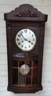 Regulatory clock with a belly - approximately 1930-1935.