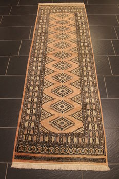Magnificent hand-knotted Buchara Jomut Oriental carpet  silk shine. 80 x 250 cm. Made in Pakistan, mid-20th century.