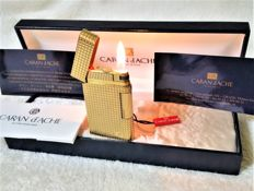 "Caran D'ache: Gold Pated ""G"" lighter, 24 ct gold 24 plating -Motifs: Sea stars"