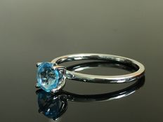 White gold ring set with topaz - brand new