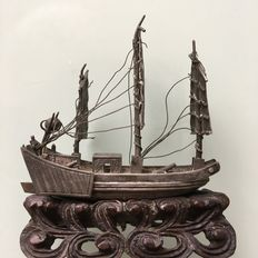 Silver sailing ship with cannons on board, on a wooden base - China - ca. 1930/1950.