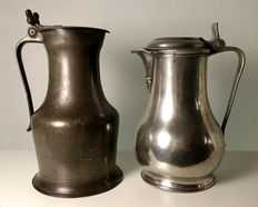 Two French pewter valve jugs: Norman and P J Chuffart Lille (1754 m)