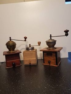 Three old still working coffee grinders