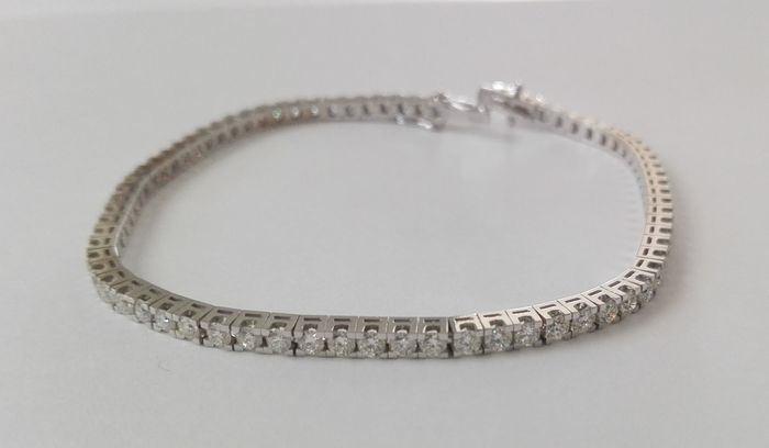 Tennis bracelet in 18 kt gold with brilliant cut diamonds for 2.52 ct - Length 18 cm