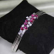 Beautiful solid satiny silver bracelet with very nice genuine Rubies ca. 1,28Ct and white Topas ca. 0,30Ct. Excellent state.