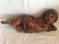 Polychrome wooden Spanish colonial sculpture of a Cupid - 18th century