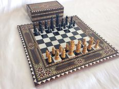 Vintage chess with marquetry board, pieces made of wood
