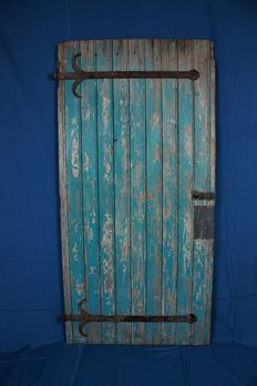 Antique door with wrought iron metal work