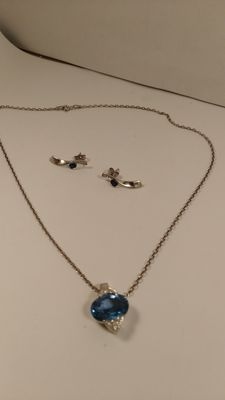 Necklace and earrings in 925/1000 silver, with light blue quartz.