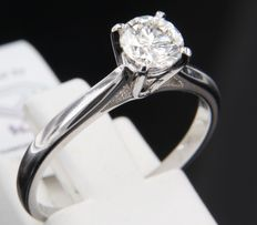 White gold 14 kt solitaire ring set with one 0.77 ct brilliant cut diamond, I VVS2