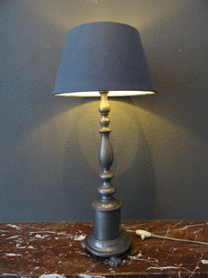 Antique tin table lamp on lion's paws